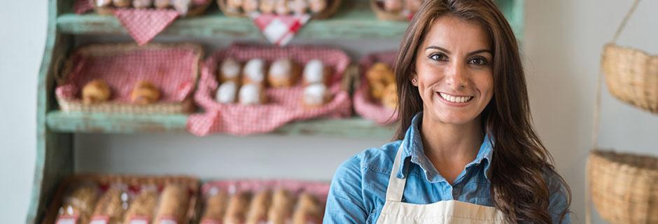 happy-business-owner-at-a-bakery-shop-mobile-desktop-940x320